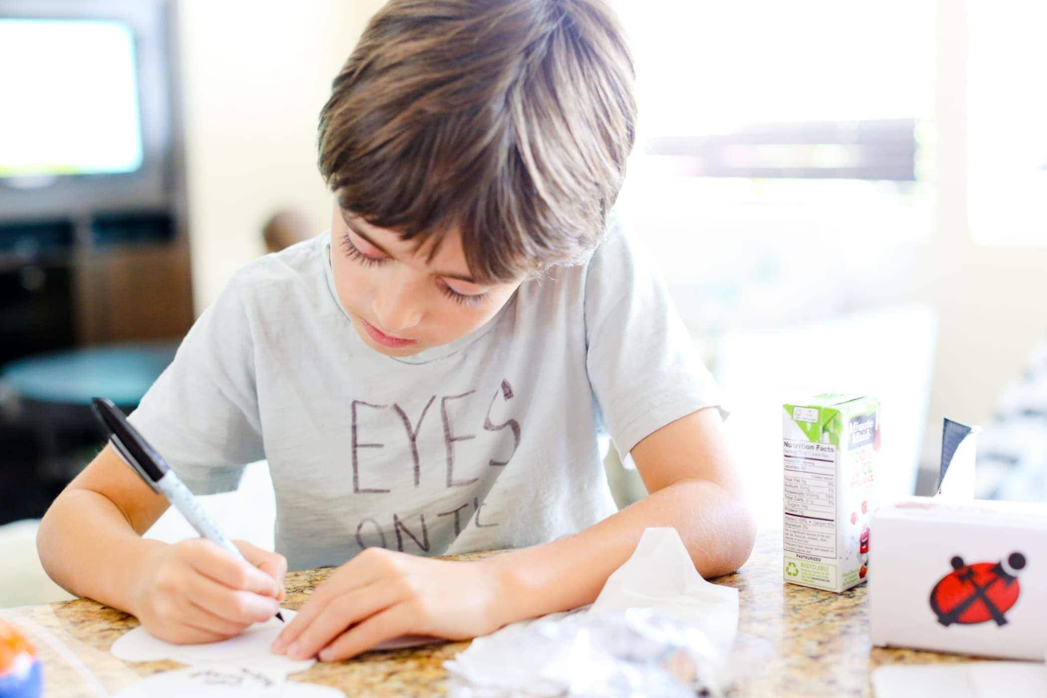 boy doing crafts