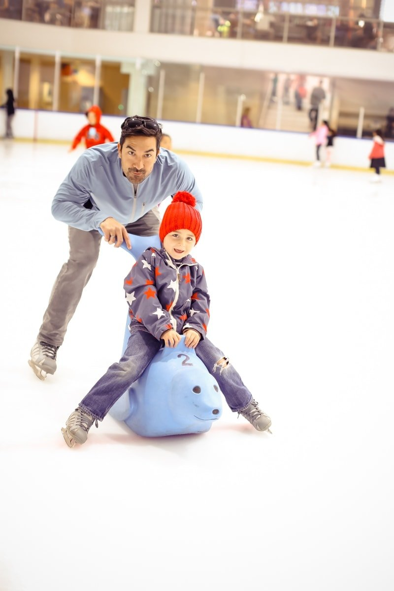 dad and son ice skating