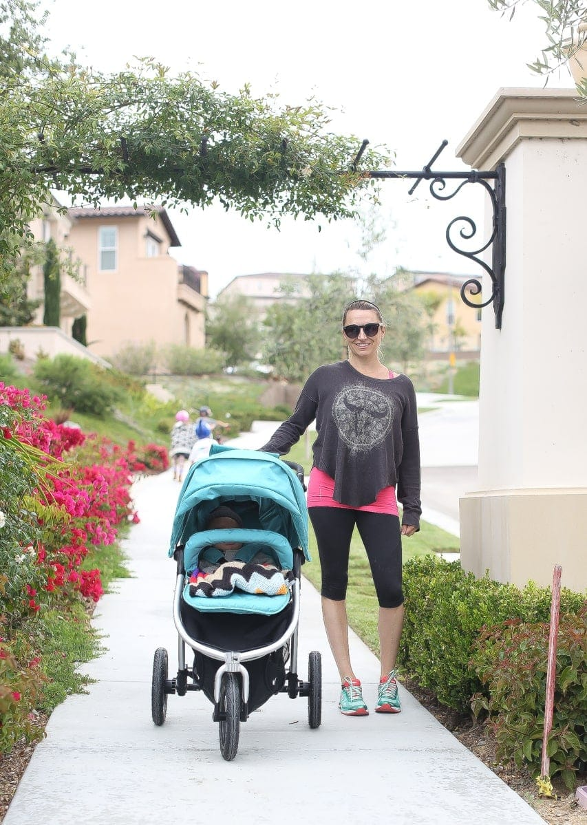 mom walking baby with stroller