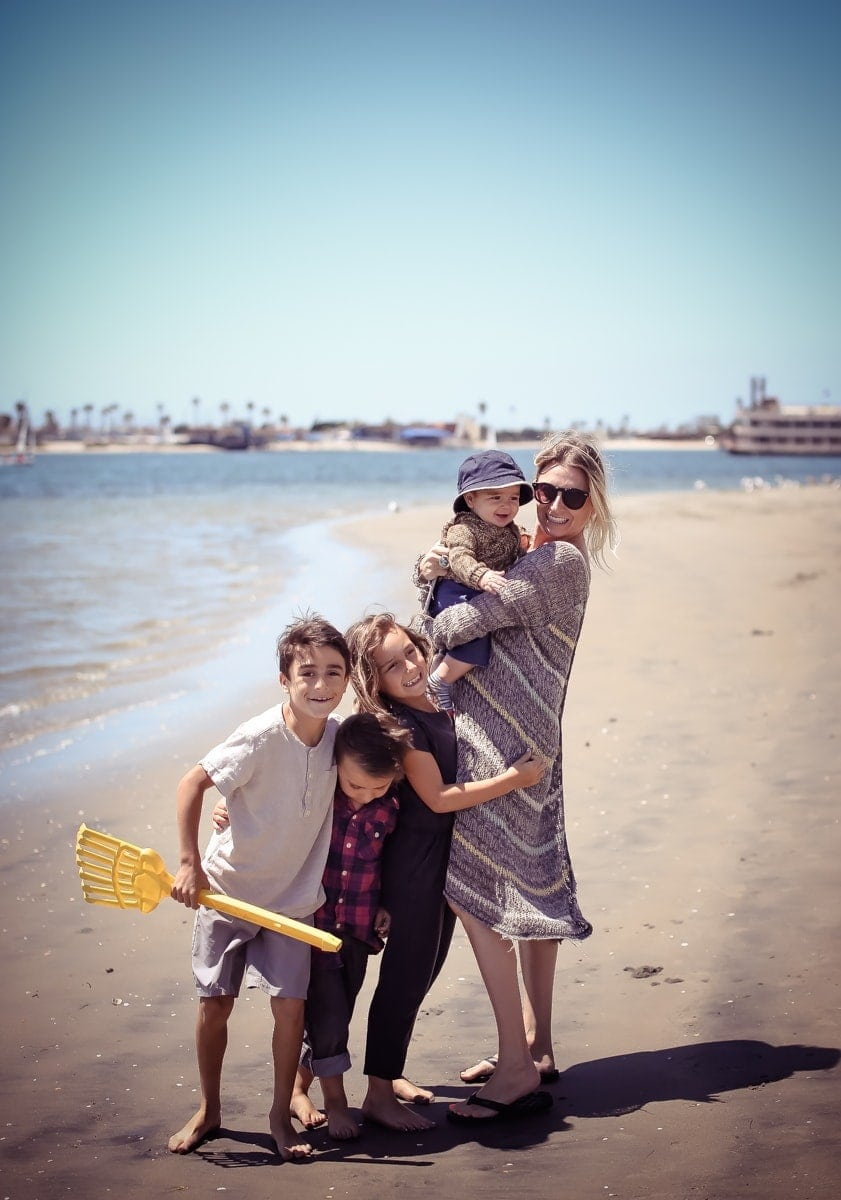 mom at beach with children