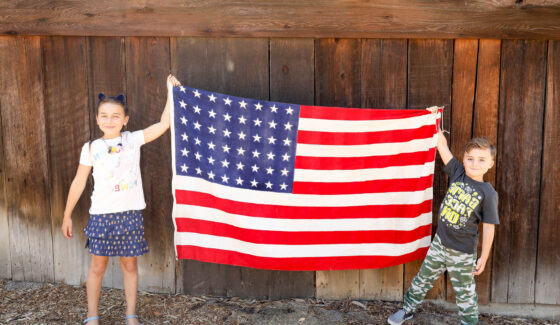 kids holding an american flag