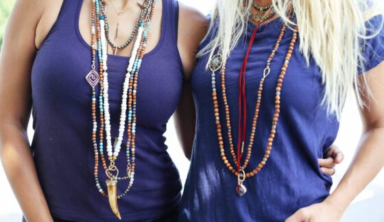 women in layered necklaces