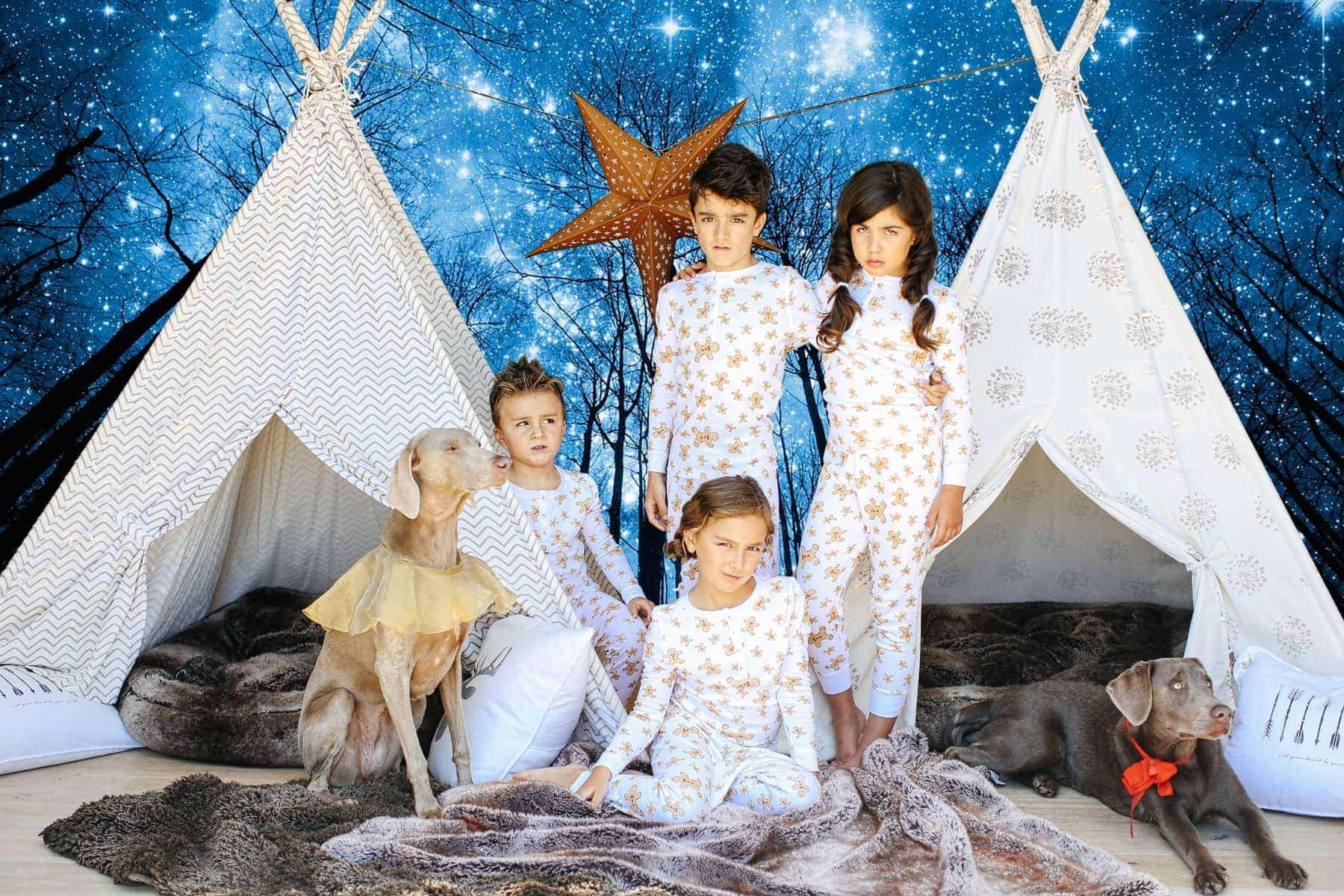 kids and dog in pajamas with teepees and night sky