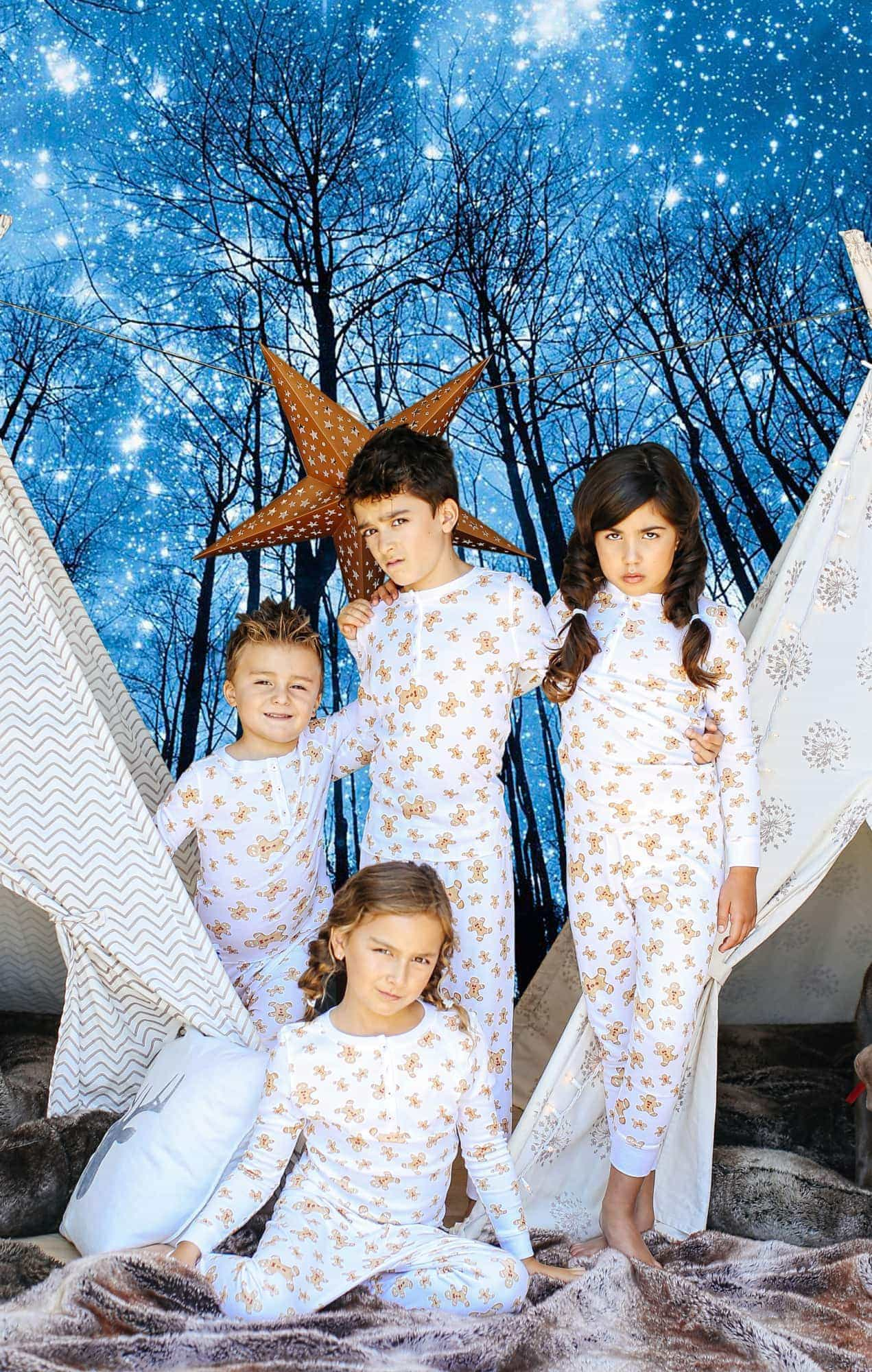 kids in pajamas with night sky