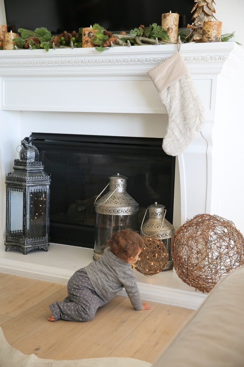 baby by fireplace decor