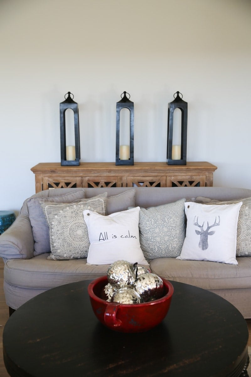 lamp lights, couch, pillows, table, decorations, silver balls