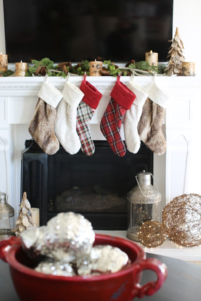 mantle decor, stockings, silver balls