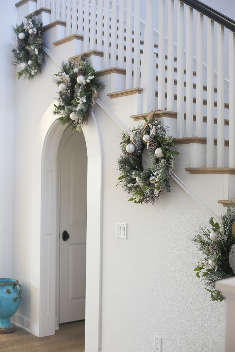entryway wreath stairs