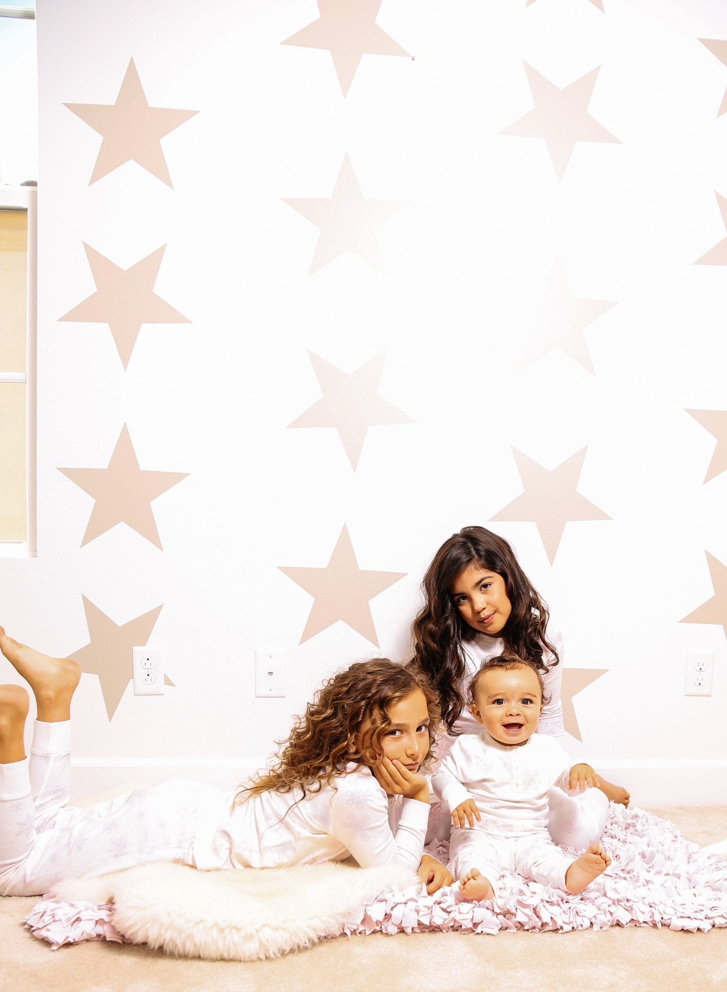 girls and baby with star background