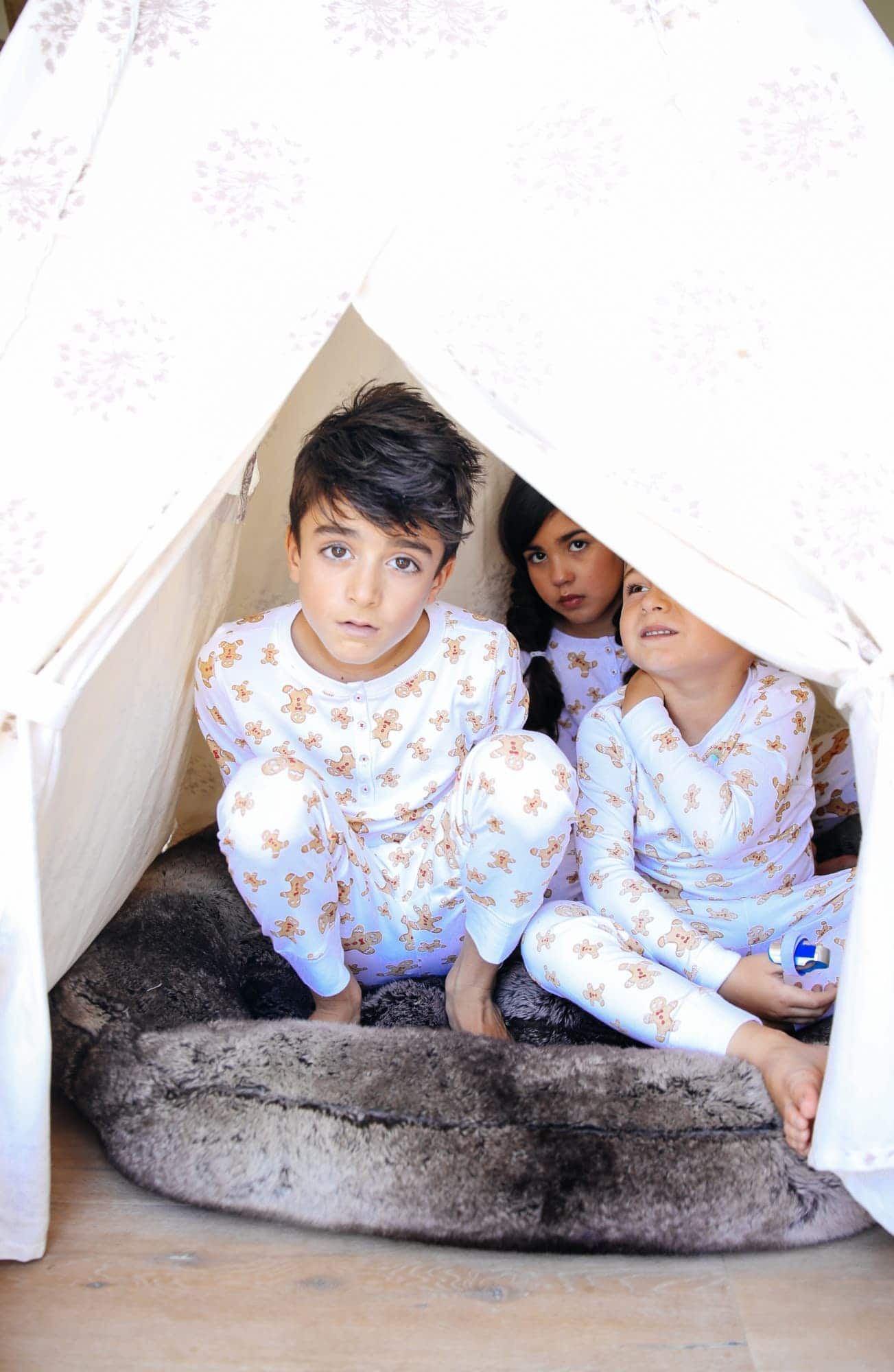 kids in tent with christmas pajamas
