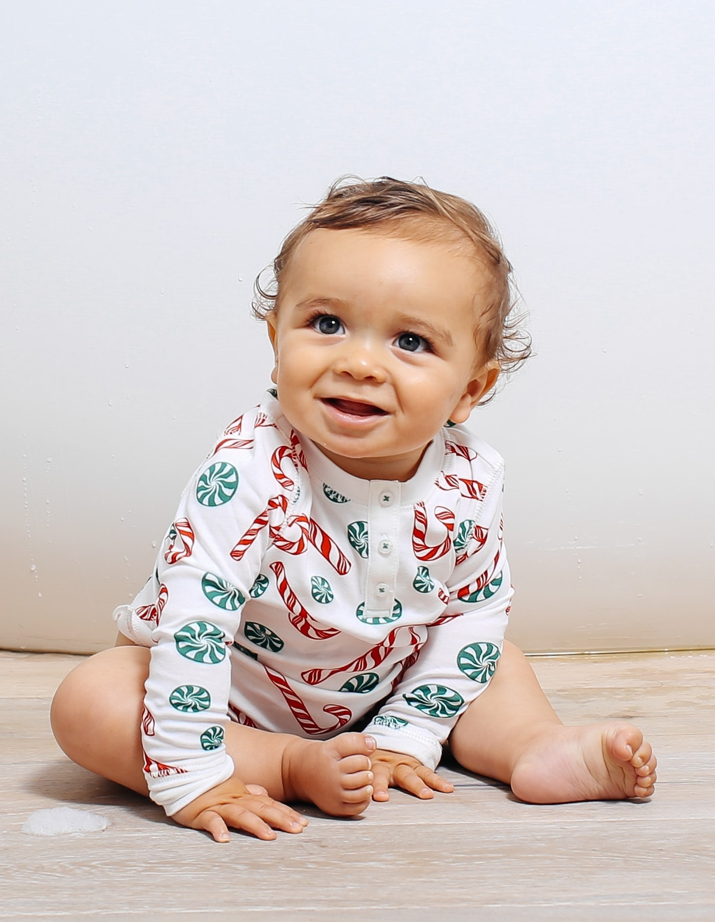 smiling baby with christmas pajamas