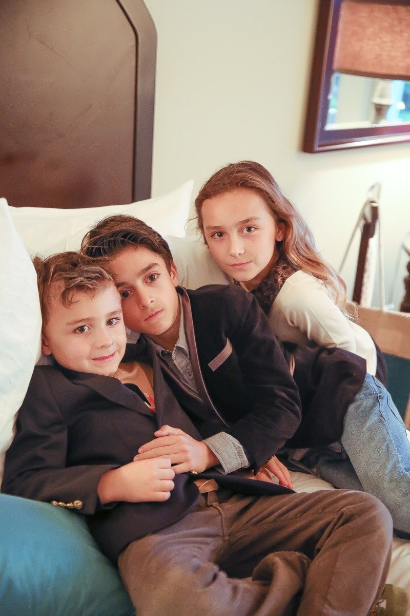 children posing on couch
