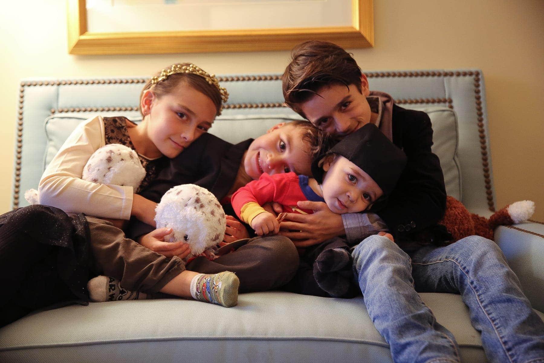 children cuddling on couch