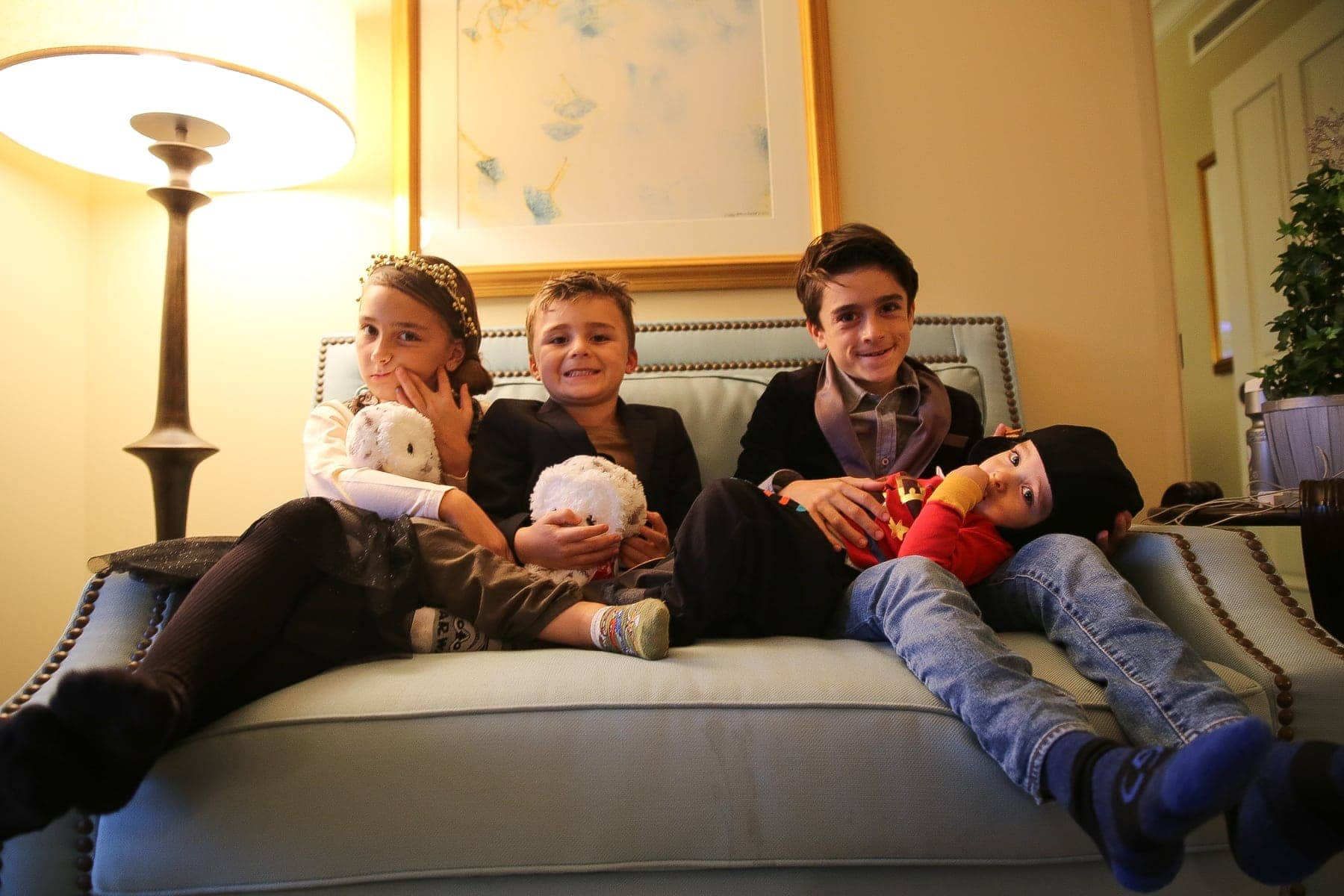 children sitting on couch in christmas best