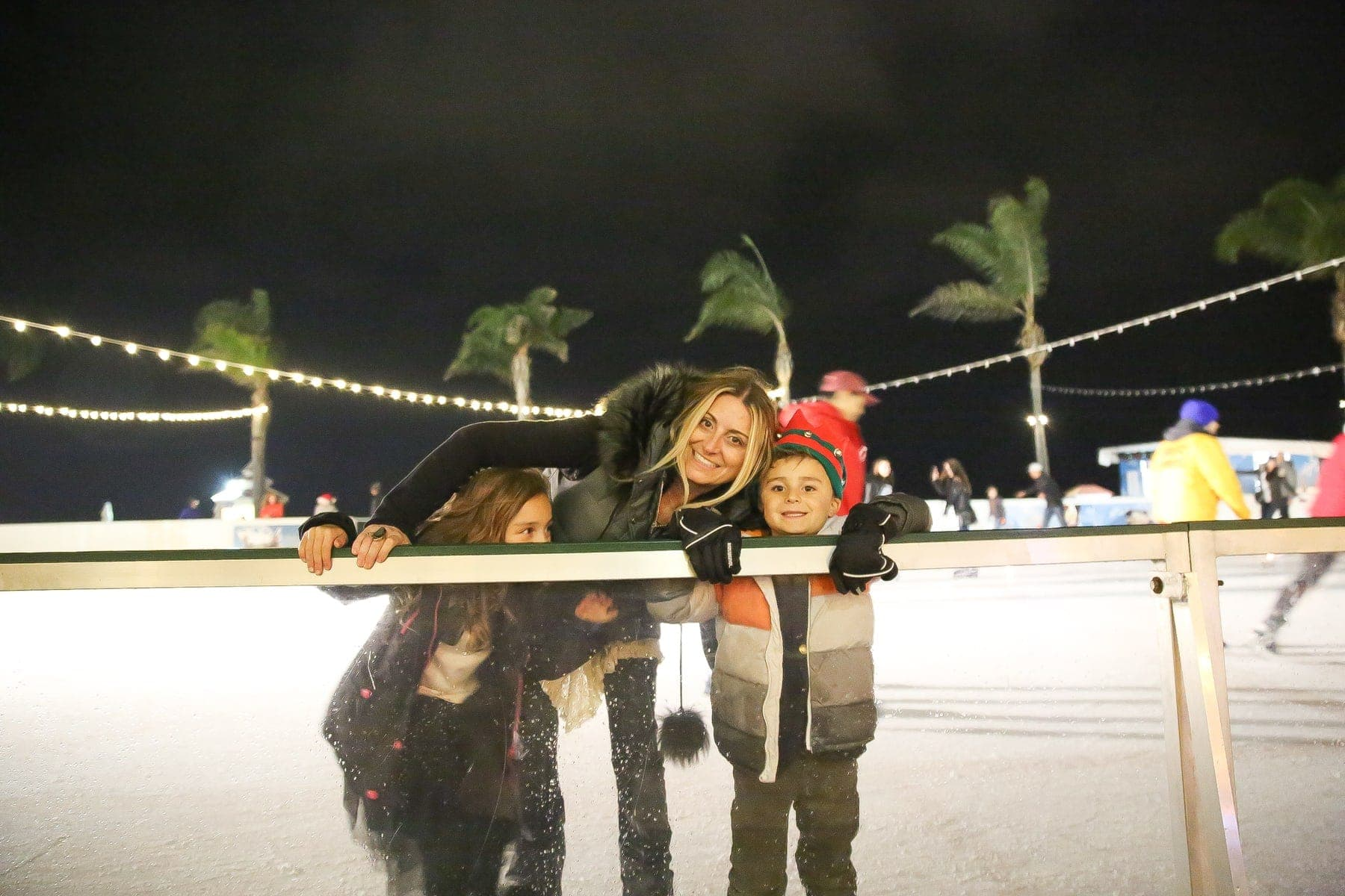 mother and children ice skating