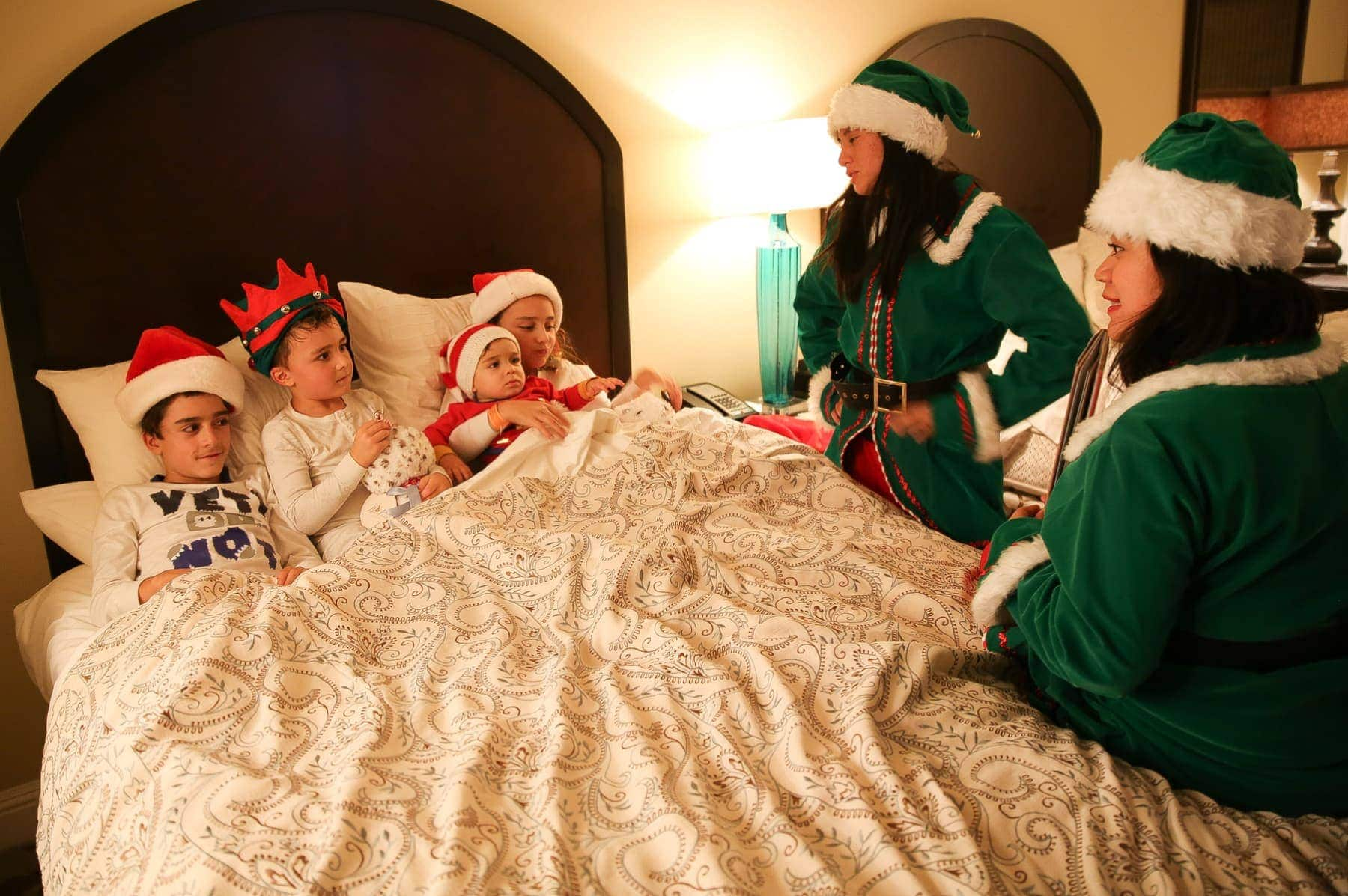 kids listening to christmas bedtime story