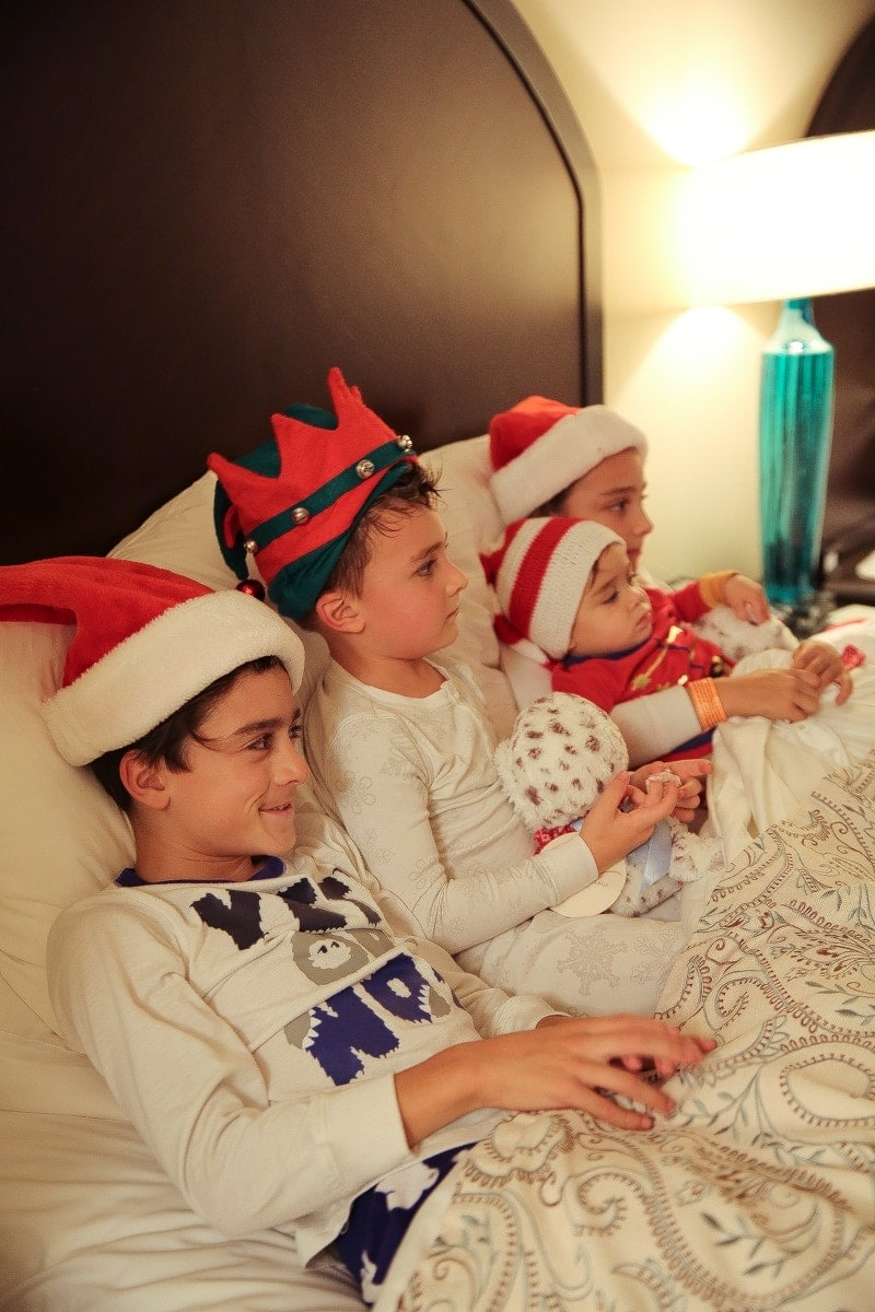 kids in bed on christmas