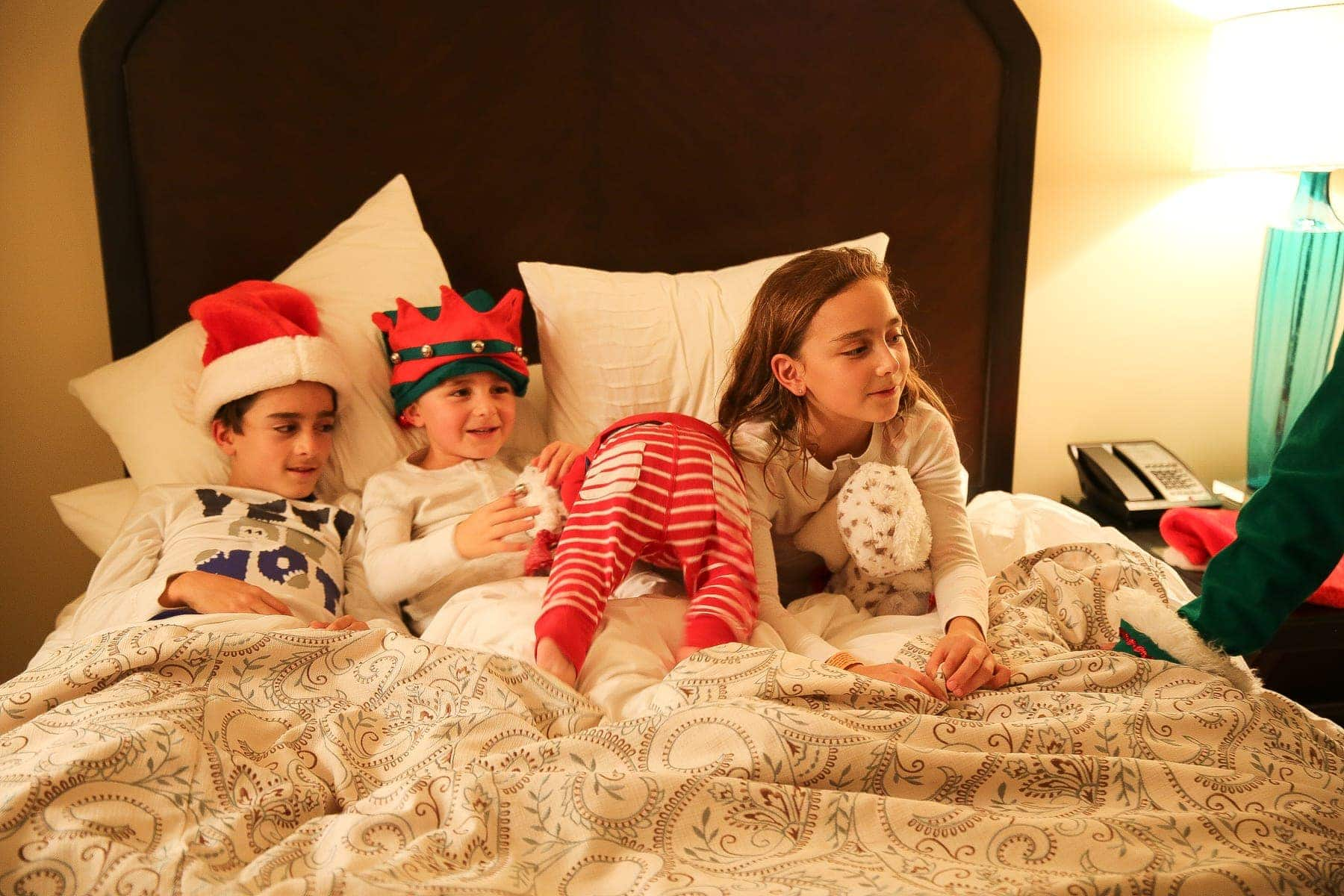 kids in bed on christmas eve