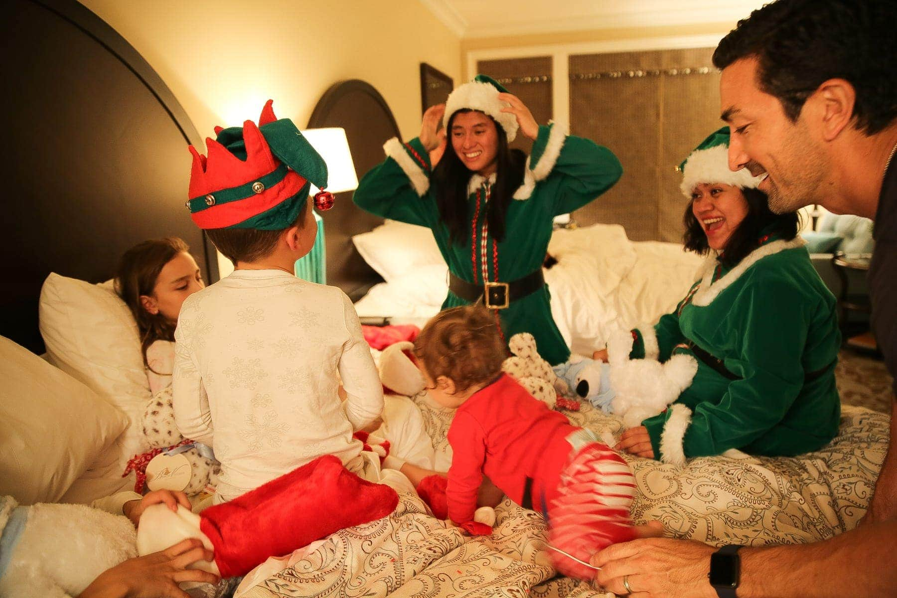 family on christmas with santa's elves