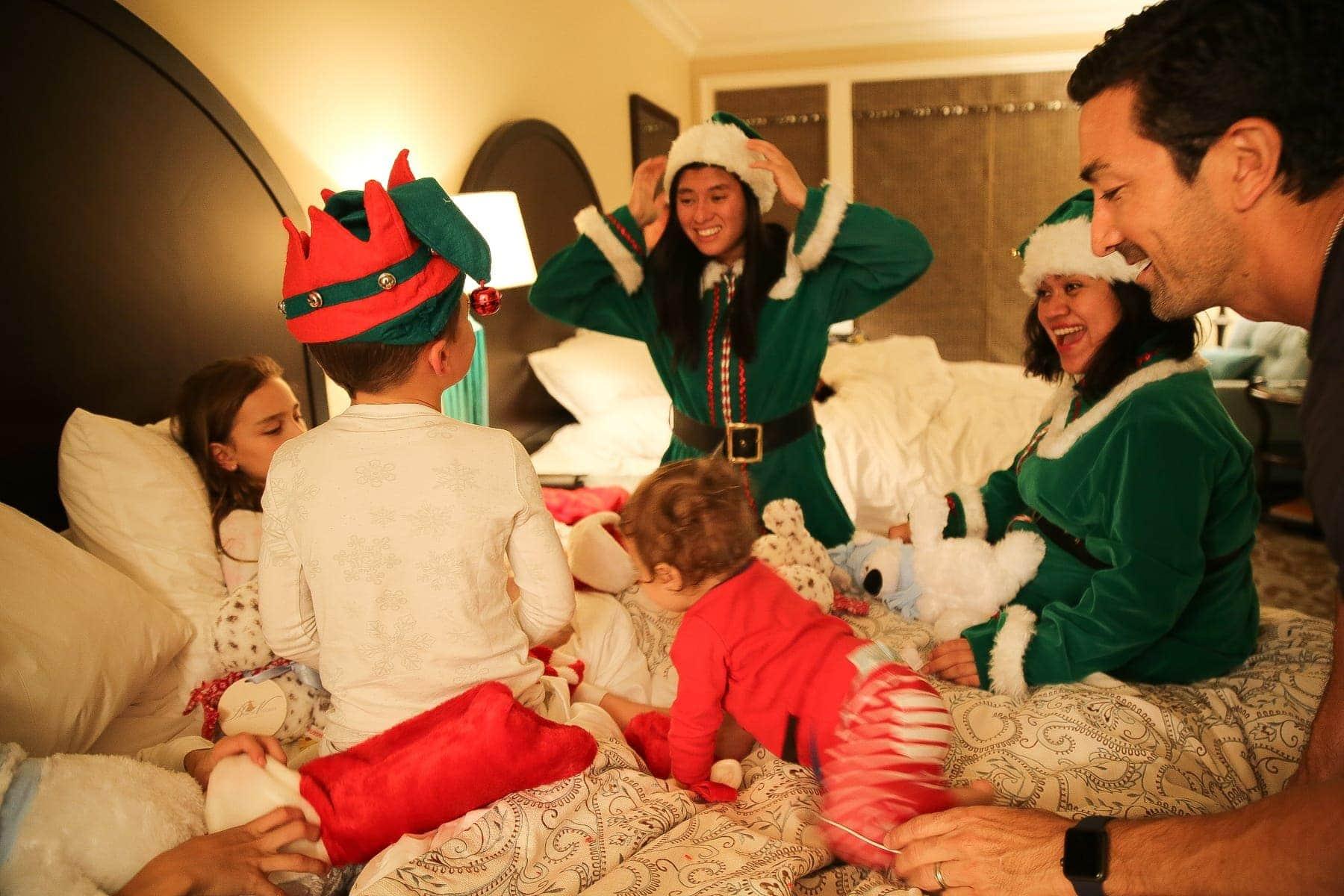 family on christmas with santa's elves