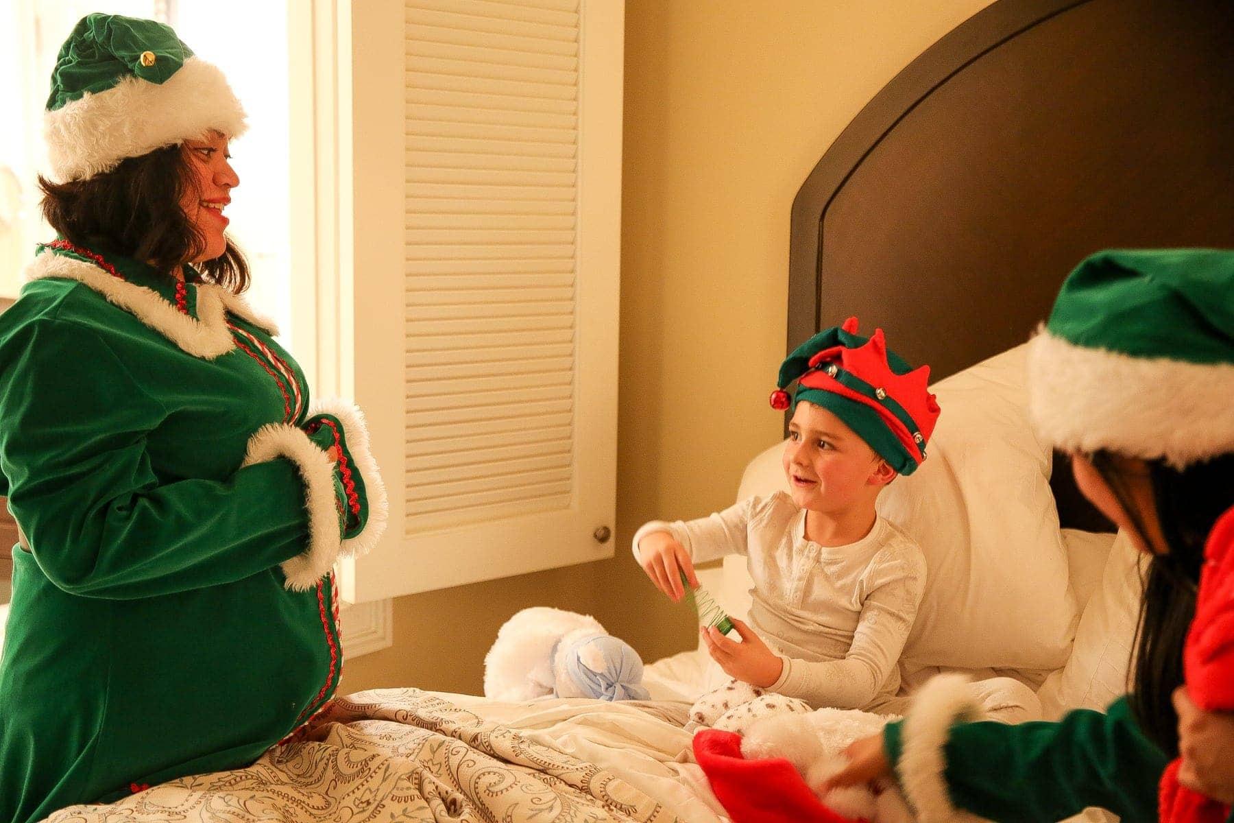 boy and santa's elves
