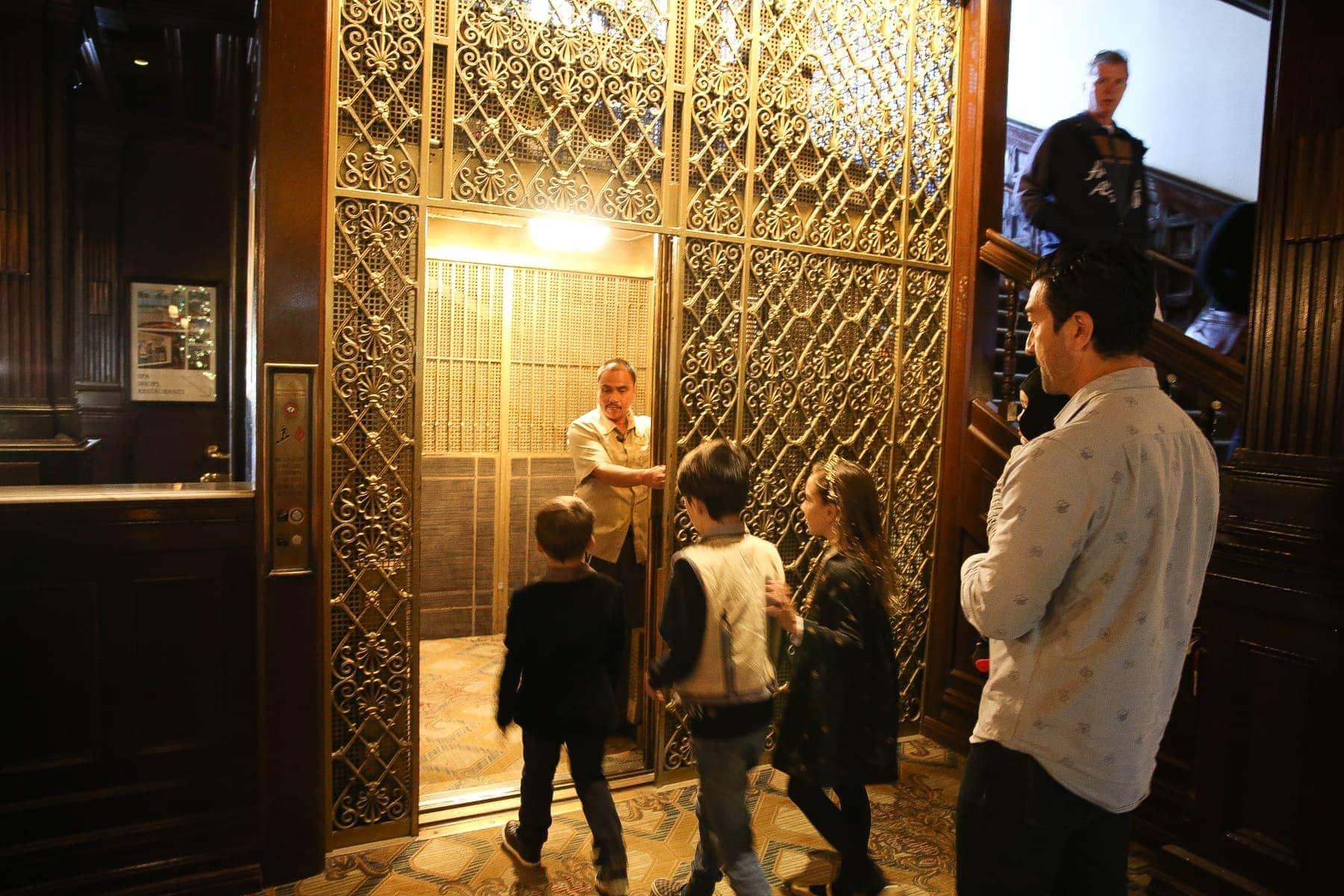 kids in old hotel elevator