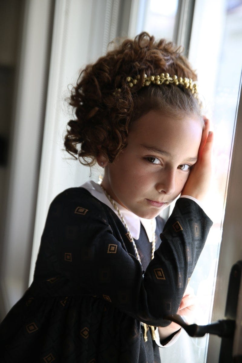 girl posing by window