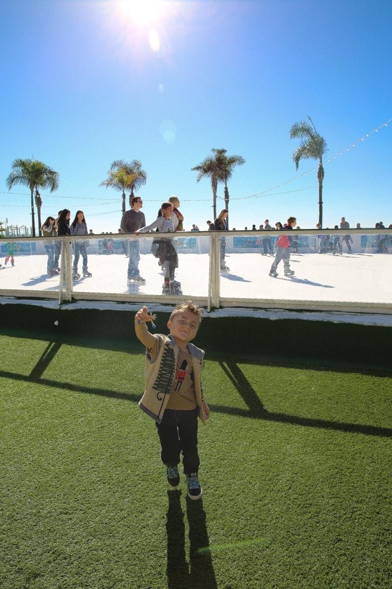 boy by ice skating rink