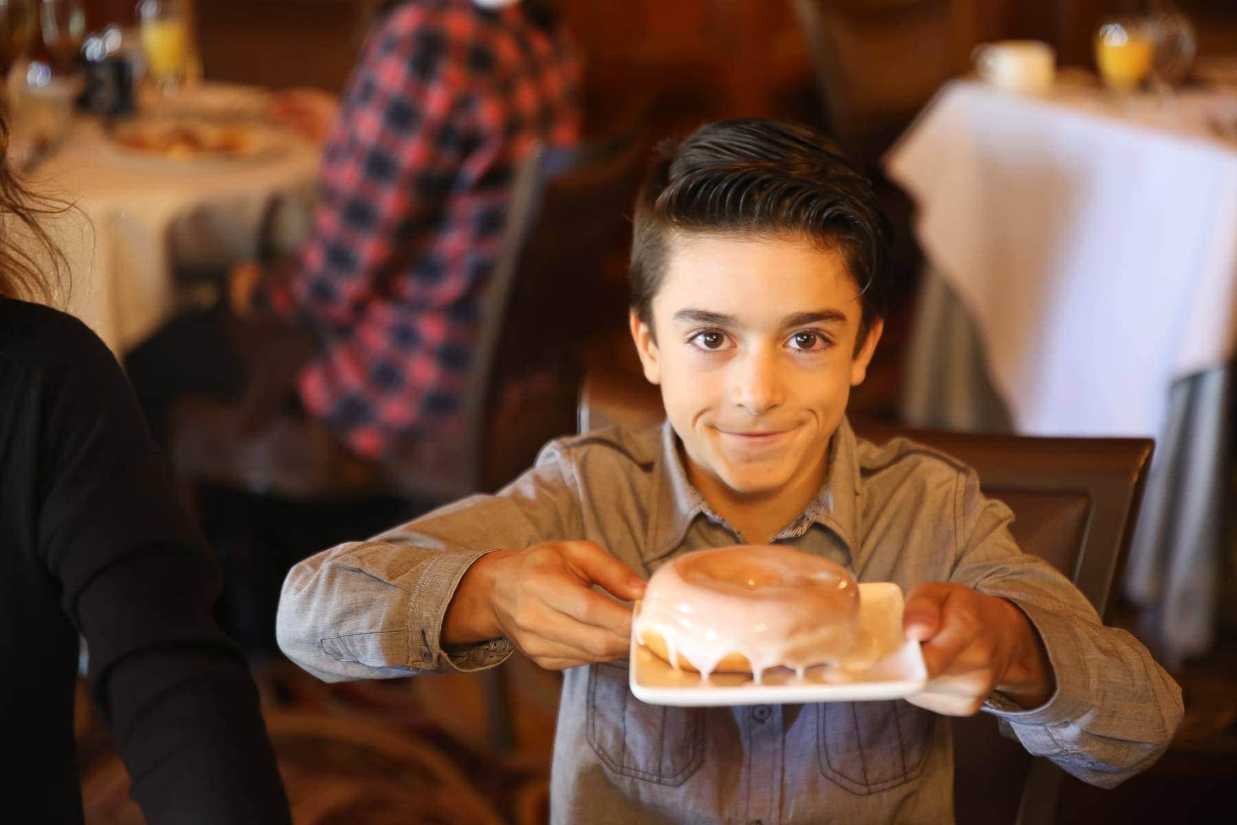 boy holding doughnut