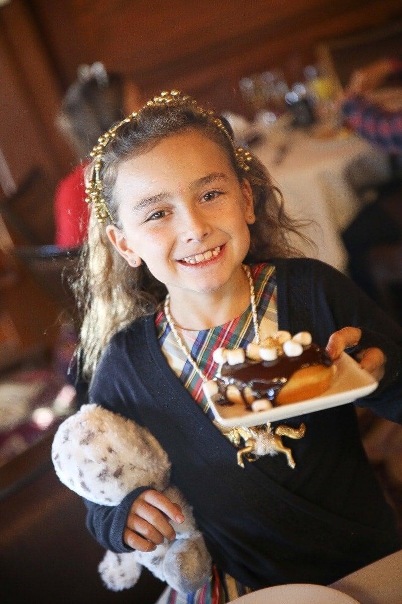 girl holding dessert
