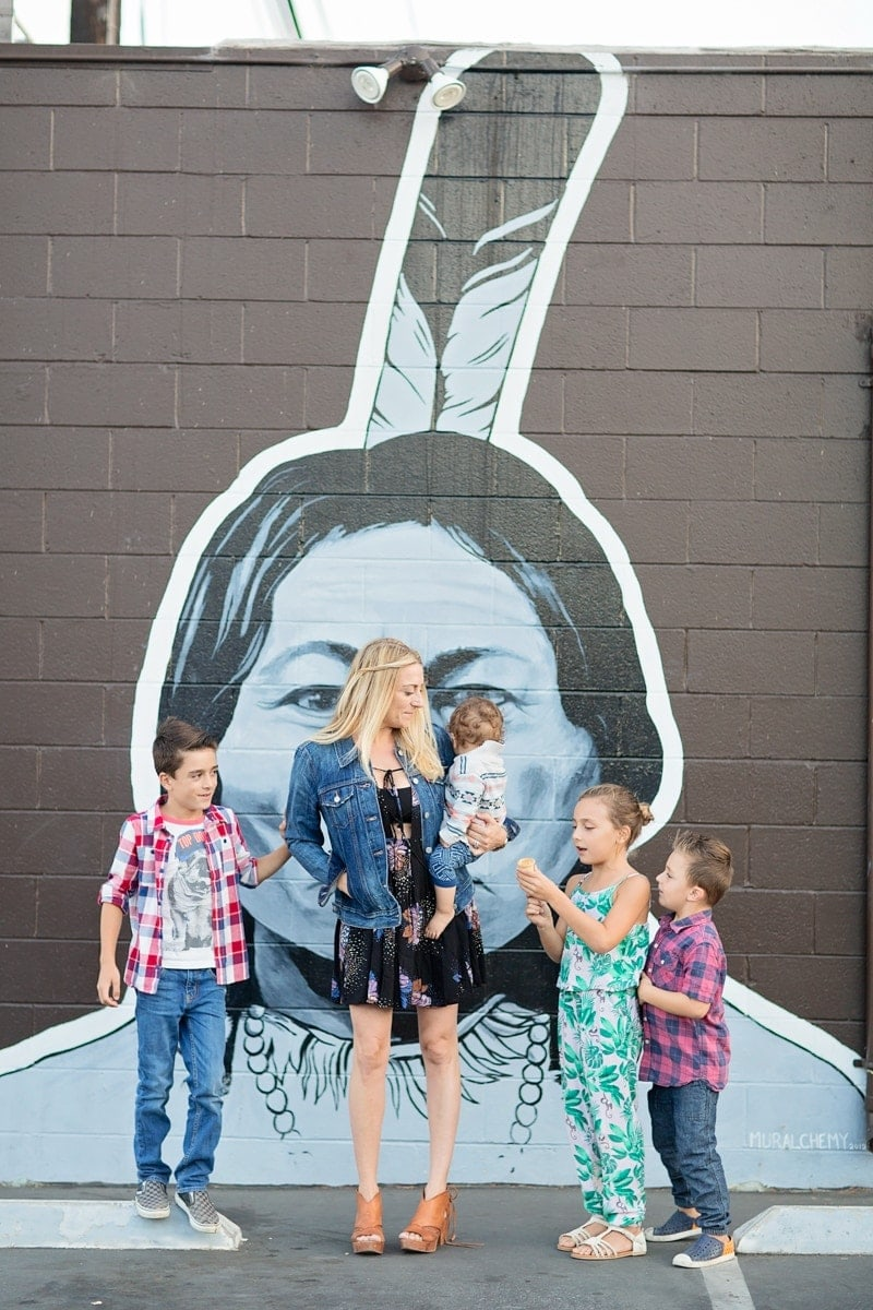 family in front of a mural