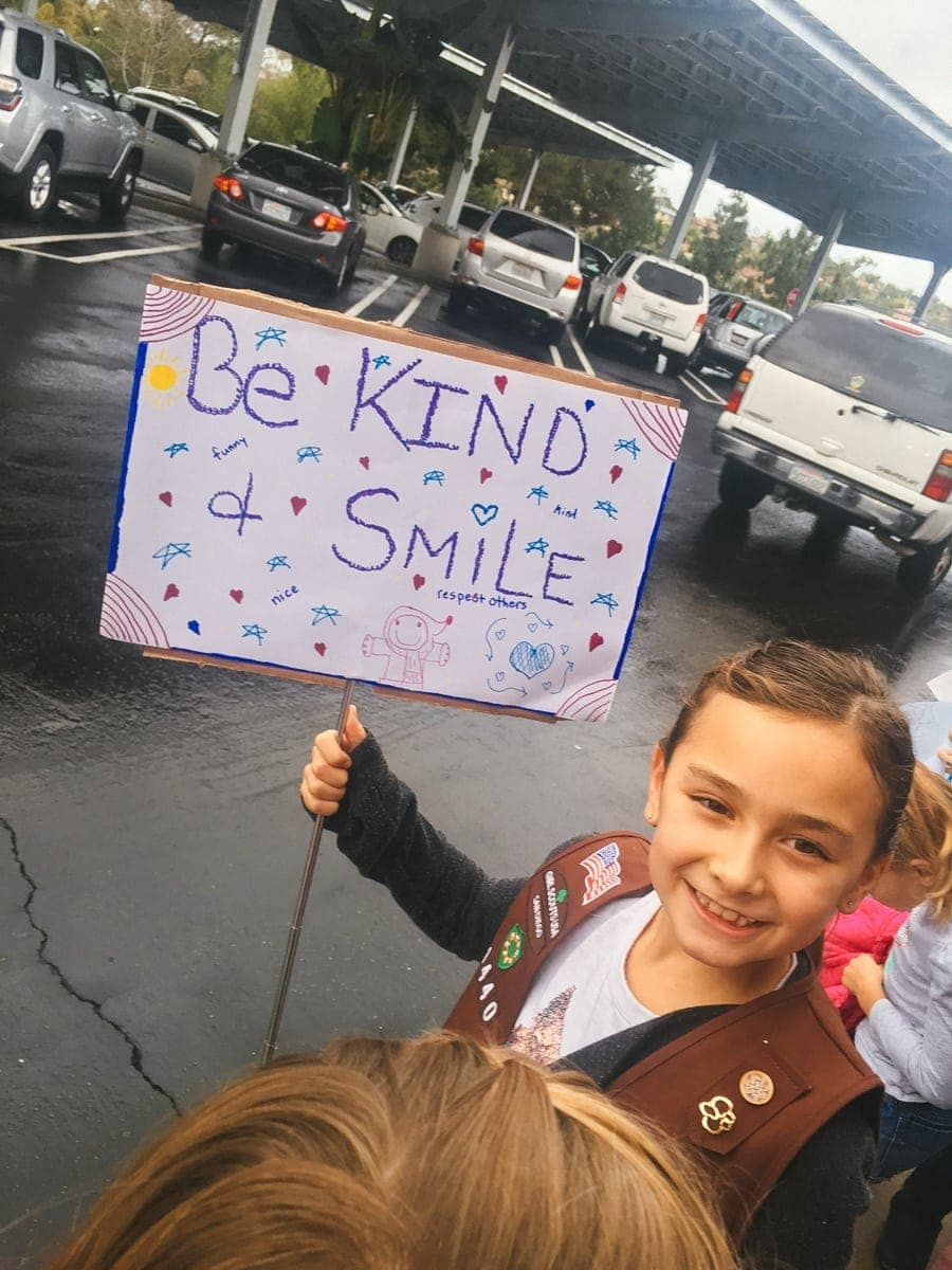 kid with be kind sign