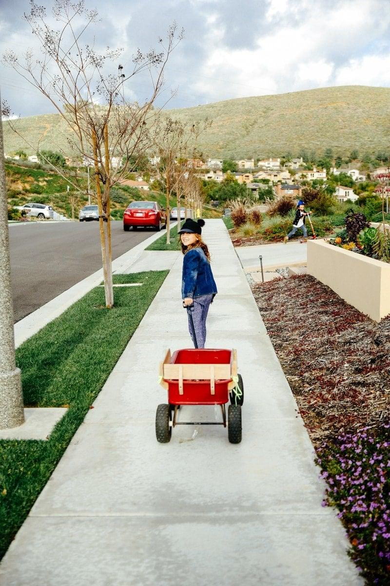 girl pulling wagon