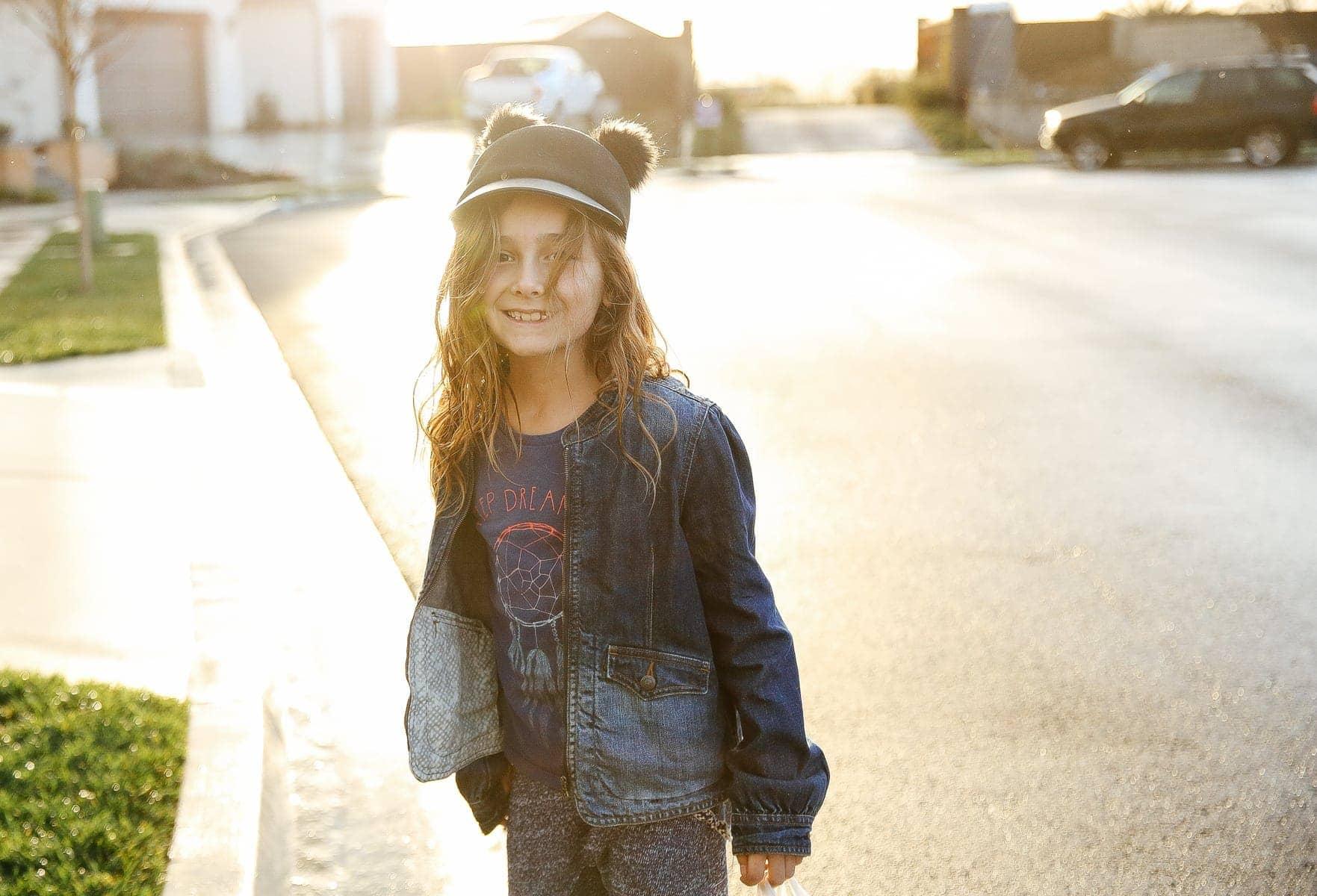 girl smiling standing on street