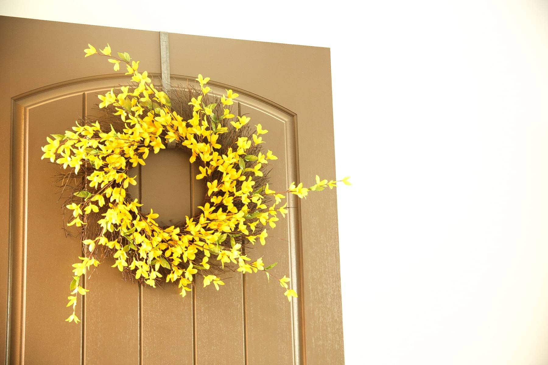yellow flowers in door wreath