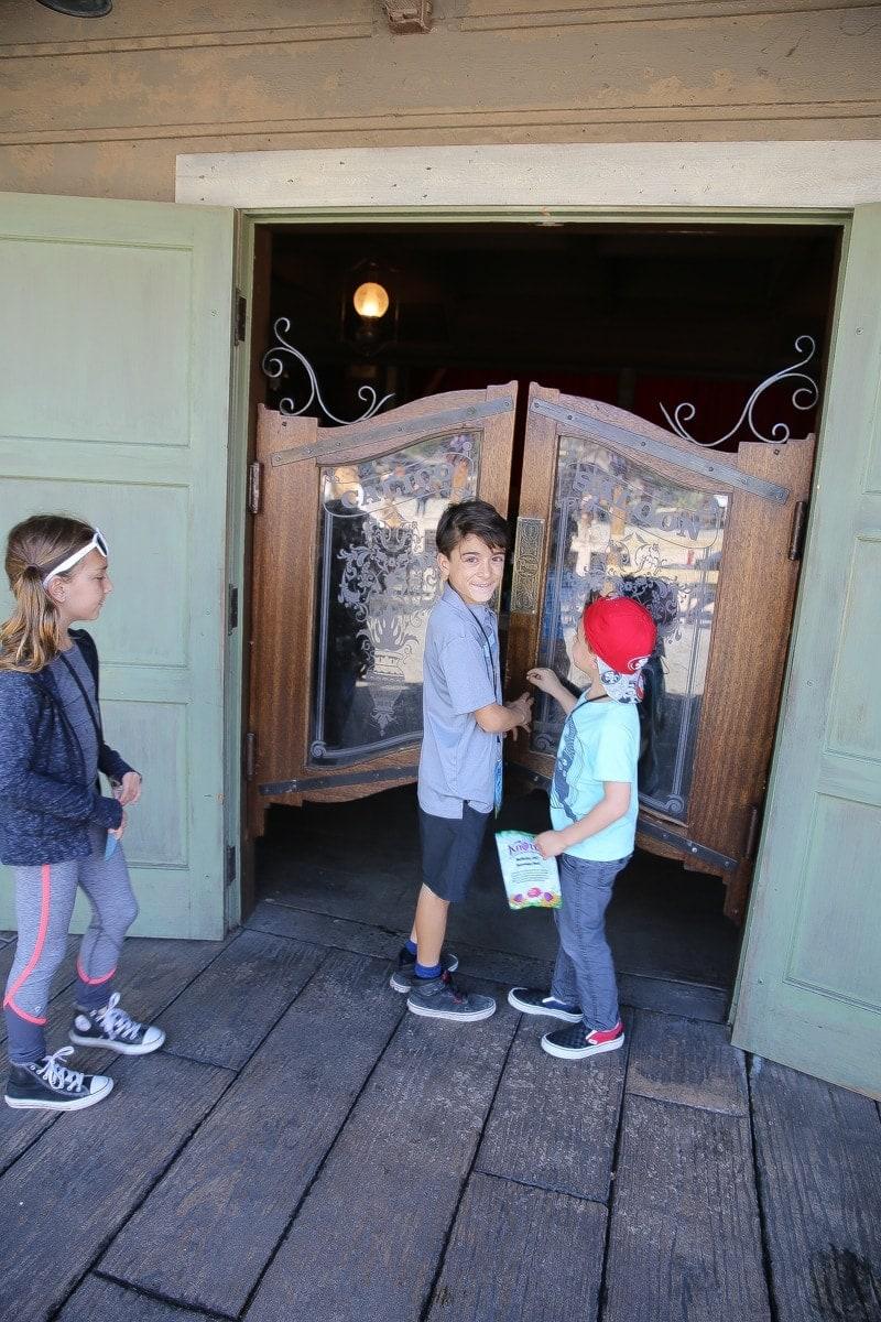 kids walking into saloon