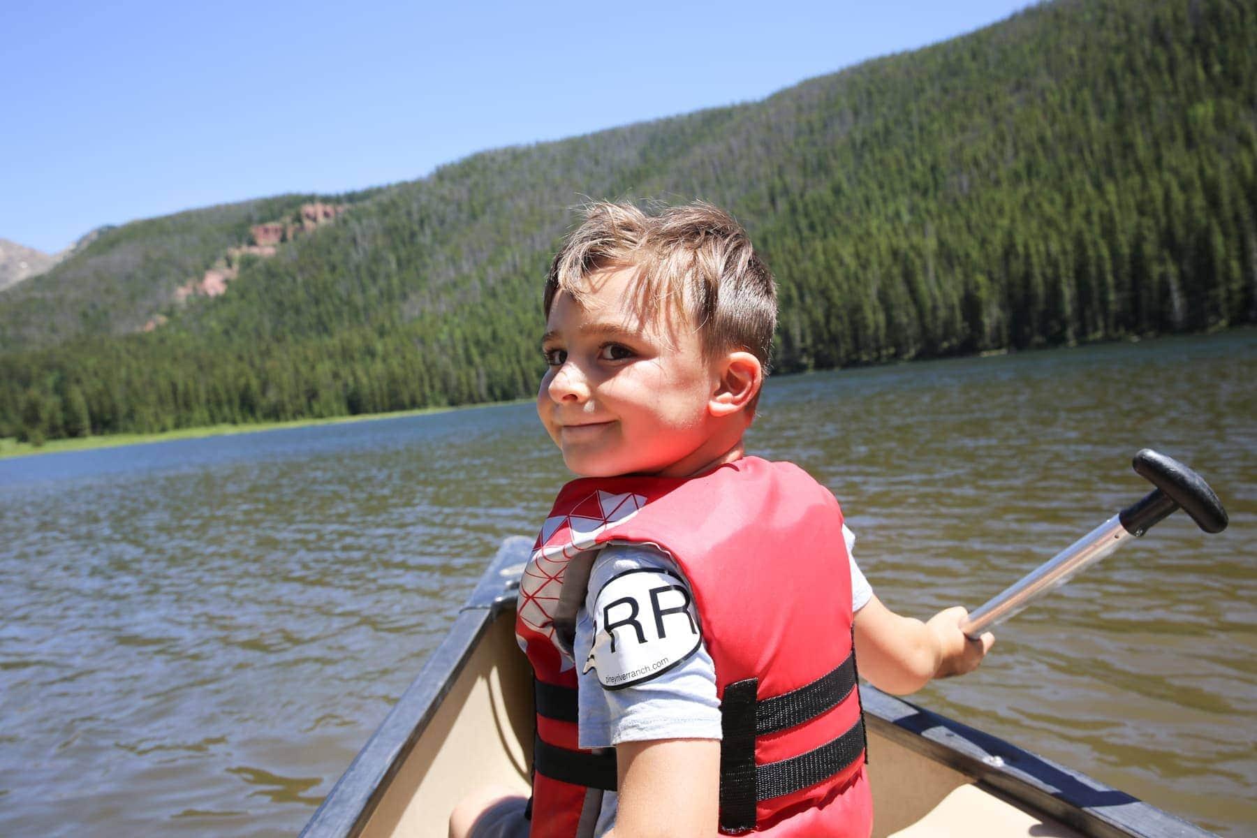 boy on canoe