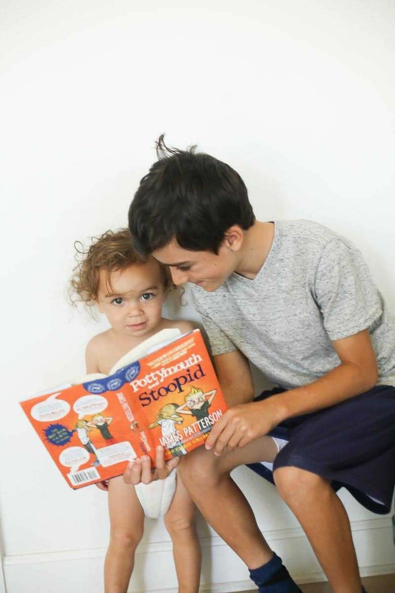 baby and brother reading