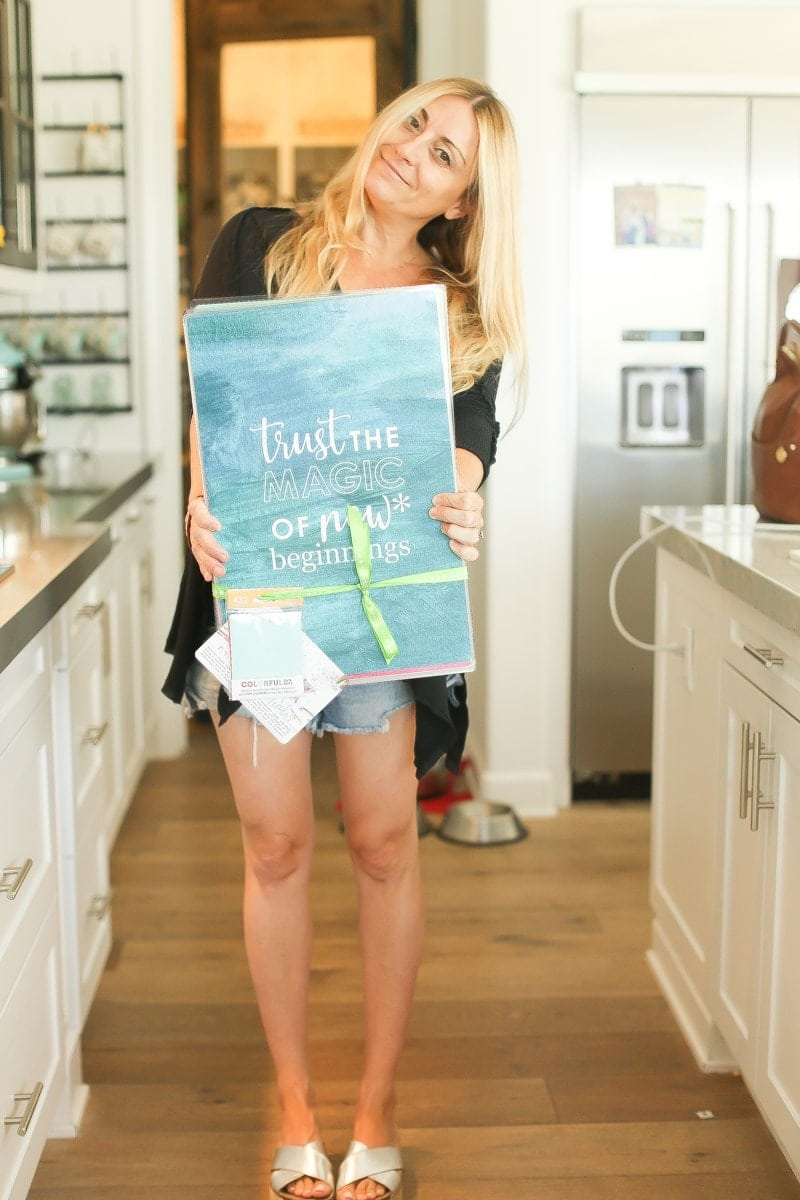 woman holding inspirational sign