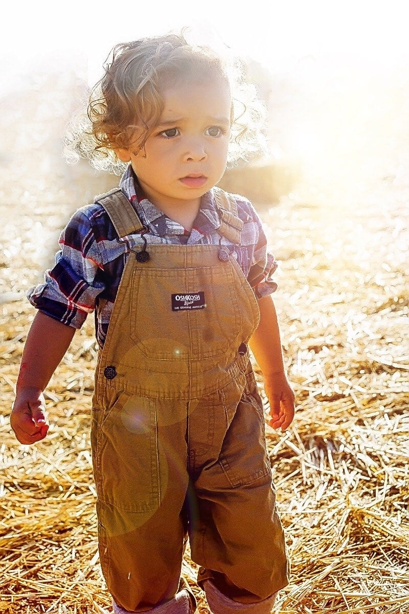 Brody in an adorable plaid shirt and canvas overalls
