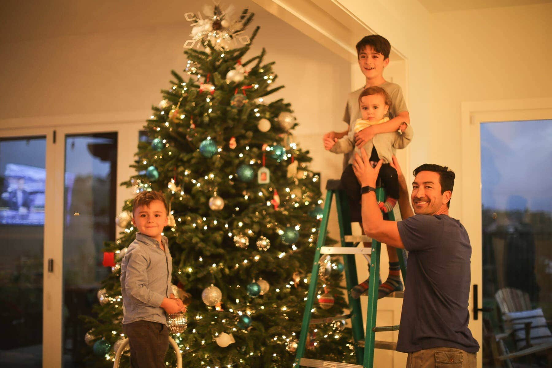 Daddy and his 3 boys decorating the Christmas tree