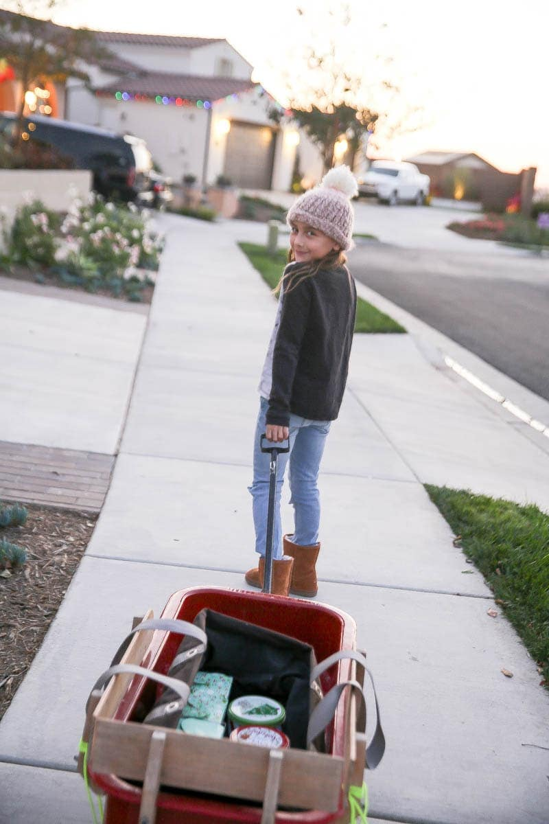 girl pulling red wagon