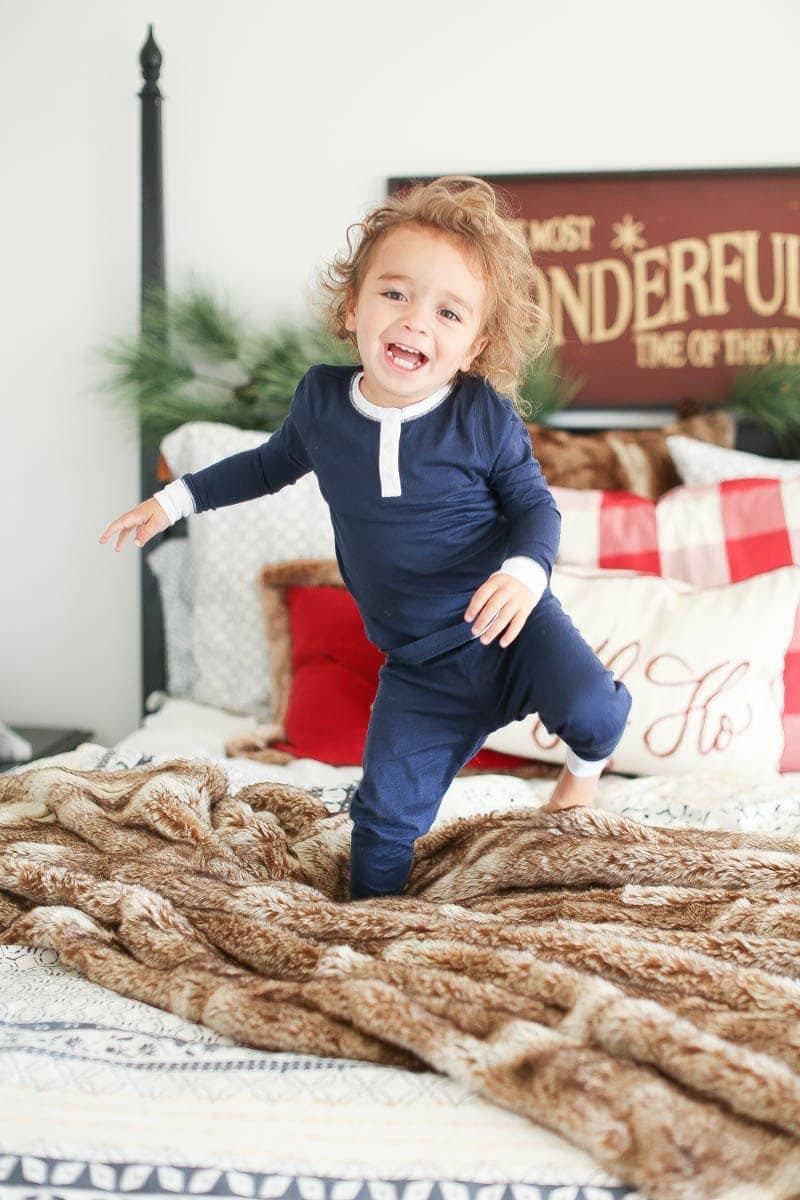 Baby jumping on bed