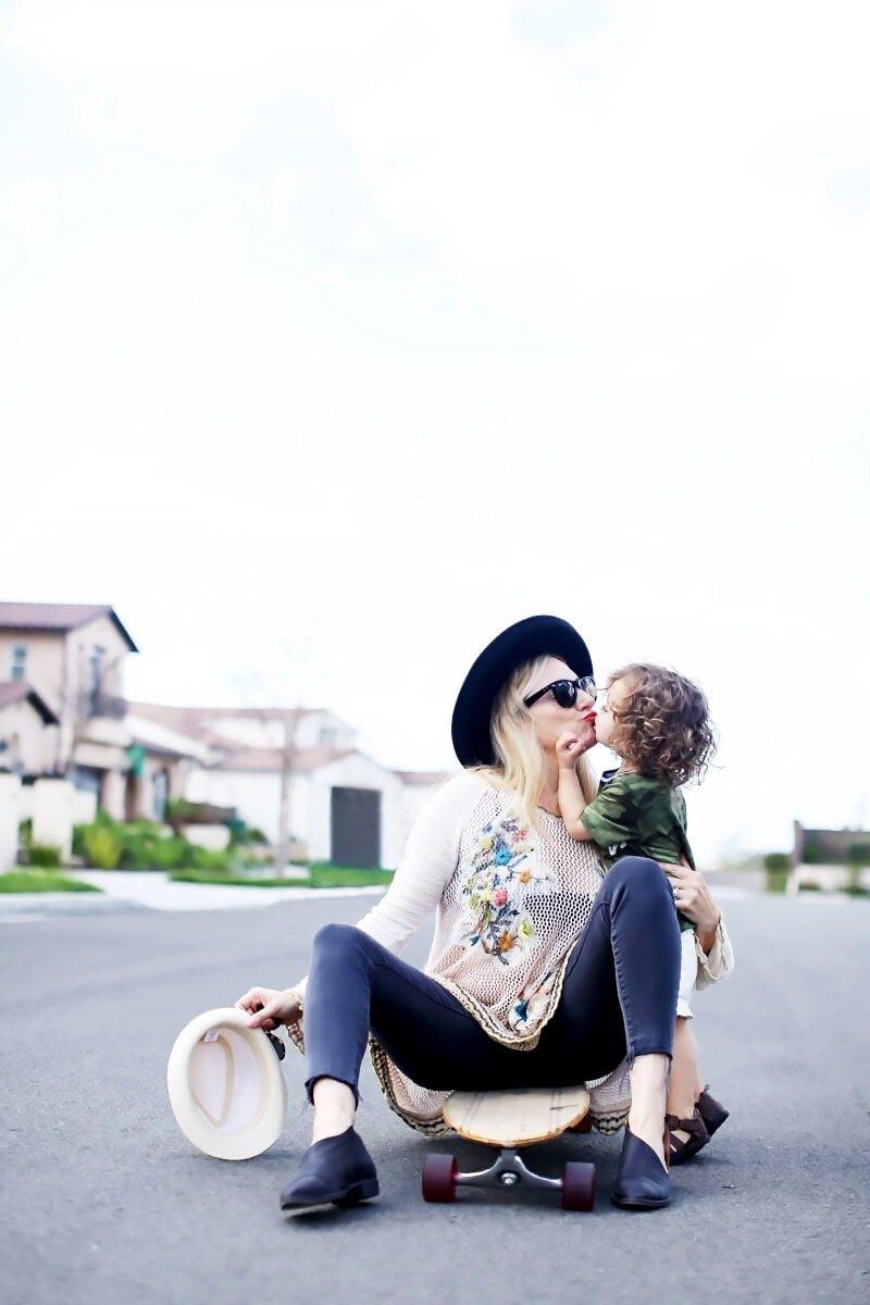mom kissing toddler