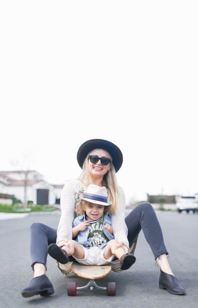 mom and son on skateboard
