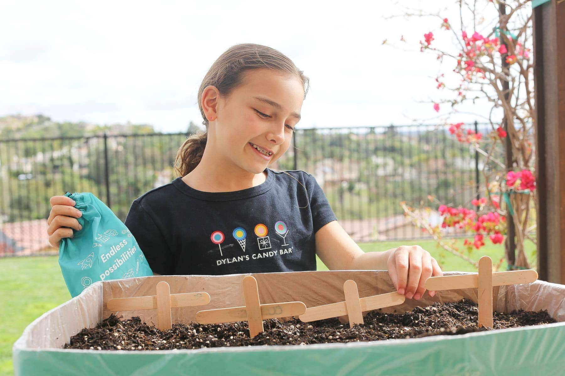 Girl arranging the labels on the Boxed mini garden