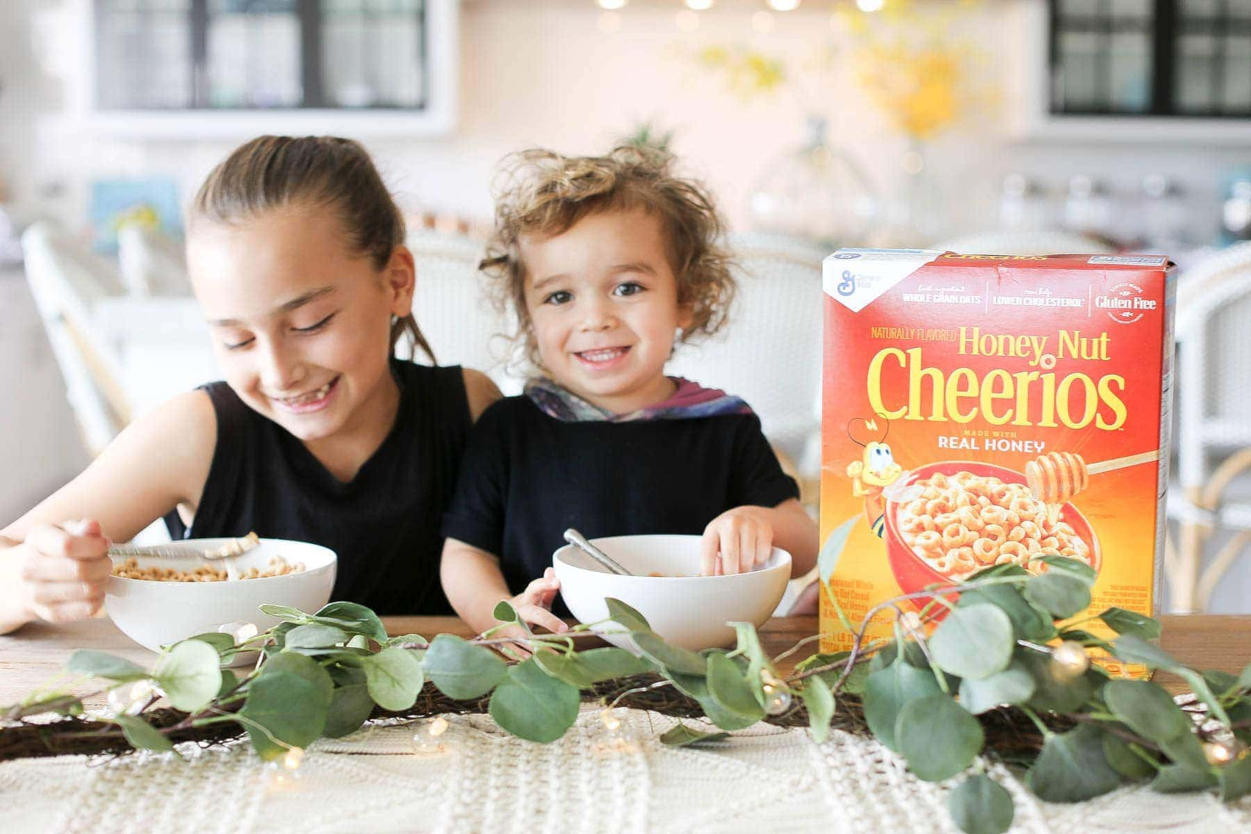 Children enjoying Honey Nut Cheerios for breakfast