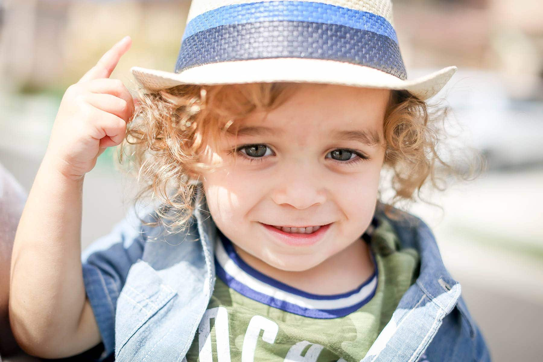 toddler with fashionable hat