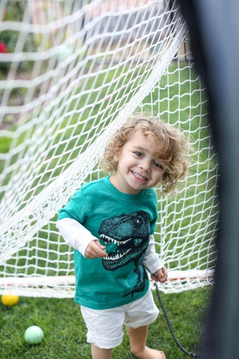 smiling boy playing ball