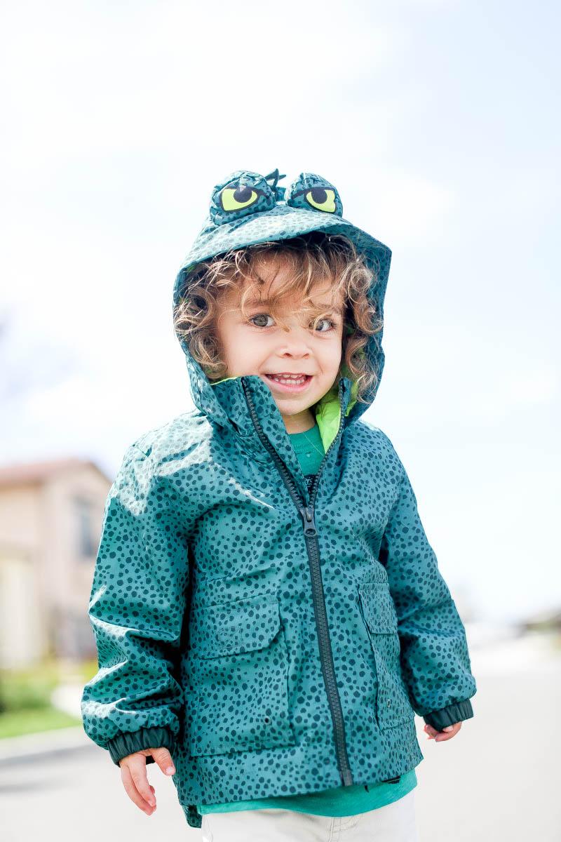 happy toddler in raincoat